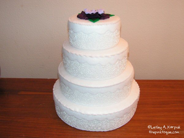 wedding cakes with flowers on top. The flowers on top were made